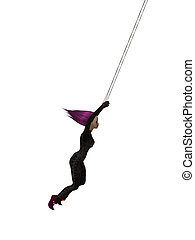 Clown Hanging On A Trapeze - Clown handing on a trapeze on a...