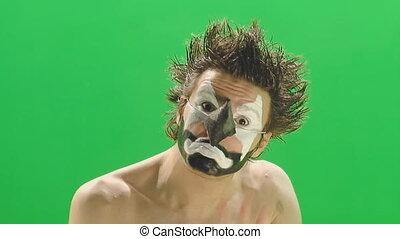 Clown in the green tv studio