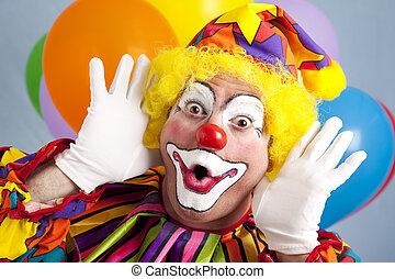Colorful birthday clown making a funny face.