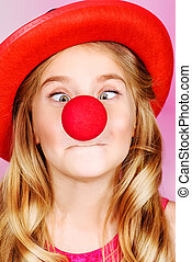 clown nose - Funny little girl wearing clown nose and hat....