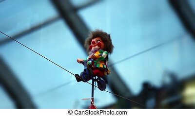 Clown on bike rides along the rope - attraction Clown on...