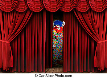 Clown on Stage Behind Curtain - A clown on stage behind a...