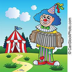 Clown playing accordion near tent