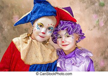 Portret of two adorable little girls in clown disguise