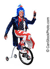 Clown Riding Unicycle with Training Wheels - Clown riding a...