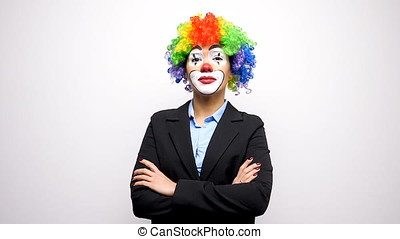 Clown with a colorful wig in business suit - Slow motion...