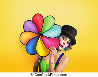 Clown with colored helix on yellow background - Clown posing...