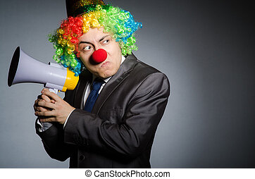 Clown with loudspeaker in funny concept