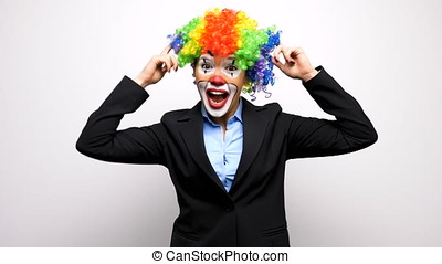 Clown woman in business suit making silly faces - Slow...
