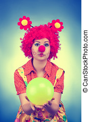Clown woman with a ball vintage toned