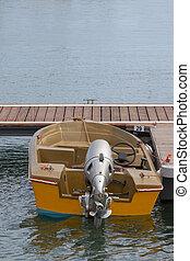anchored small fishing boat