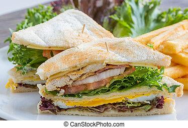 Club sandwich - Big club sandwich served with french fried ...