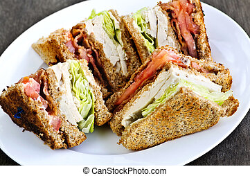 Club sandwich - Toasted club sandwich sliced on a plate