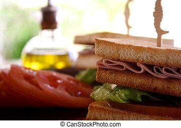 Club sandwich, tomato and olive oil on background
