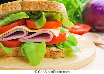 Club Sandwich with Cheese, Tomato and ham.