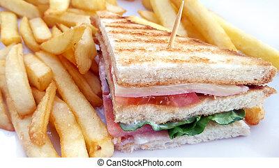 Club sandwich with french fries