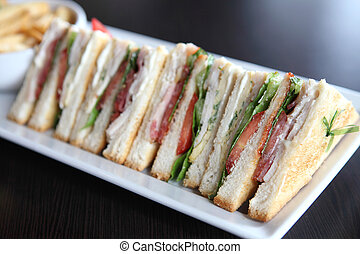 Club sandwich with on wood background