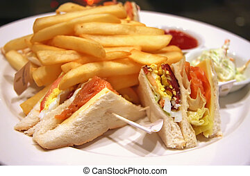 Club sandwiches with smoked salmon and french fries