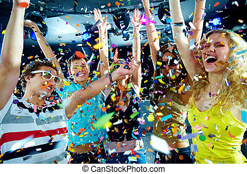 Clubbers having fun - Photo of excited teenagers in confetti...