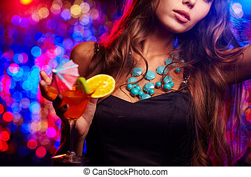 Young girl clubbing at nightclub