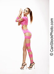 Clubbing. Redhead Woman in Pink Stagy Costume