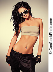 clubbing - Attractive girl dancing in a modern style at...