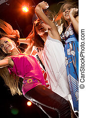 Clubbing - View from below of glamorous girls dancing at...