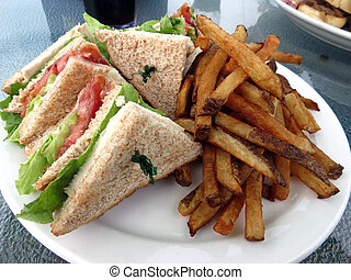 Clubhouse and Fries - Clubhouse sandwich on whole wheat,...