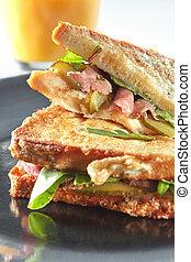 Clubhouse sandwich closeup - Clubhouse sandwich on a black...