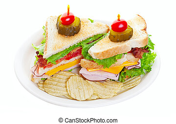 Clubhouse Sandwich - Clubhouse sandwich topped with a pickle...
