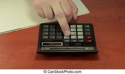 Clumsy man is using calculator - Man middle finger is...