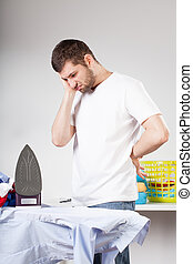 Clumsy man left with ironing - A clumsy man not knowing how ...