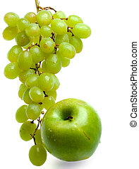 Cluster of grapes in water drops and apple
