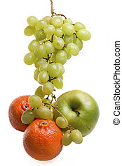 Cluster of grapes in water drops , apple and tangerines