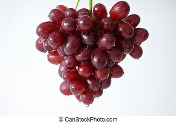 Cluster of red grapes on white background