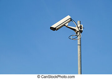 Cluster of security cameras at entrance to secure area. -...