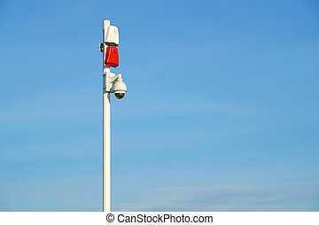 Cluster of security cameras with sound sirens at entrance to...