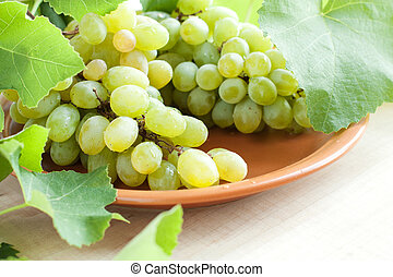 Clusters of muscat grapes on a plate