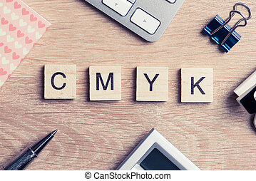 CMYK abbreviation of blocks as photography concept on business w