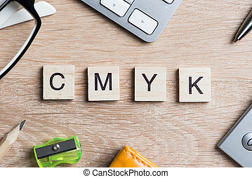 CMYK abbreviation of blocks as photography concept on business workplace