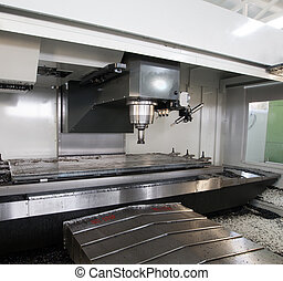 CNC (Computer Numeric Controlled) Milling machine checking...