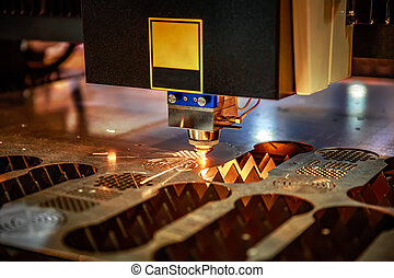 CNC Laser cutting of metal, modern industrial technology. ....
