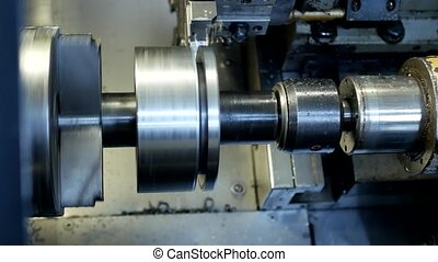 CNC lathe pulls out part of metal workpiece pulley, modern lathe for metal processing, close-up