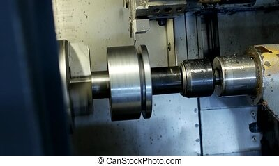 CNC lathe pulls out part of metal workpiece pulley, modern lathe for metal processing, close-up, metalwork