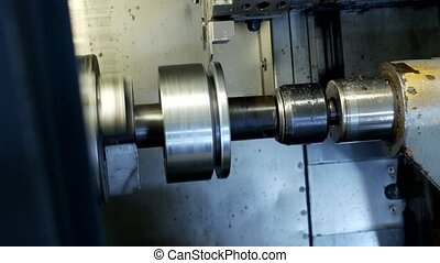 CNC lathe pulls out part of metal workpiece pulley, modern lathe for metal processing, close-up, metal