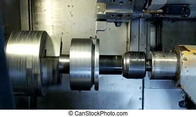 CNC lathe pulls out part of metal workpiece pulley, modern...