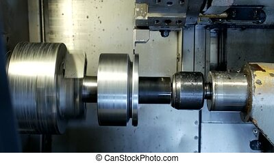 CNC lathe pulls out part of metal workpiece pulley, modern lathe for metal processing, close-up, turning