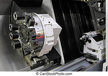 CNC lathe - Rotating head at CNC lathe in workshop