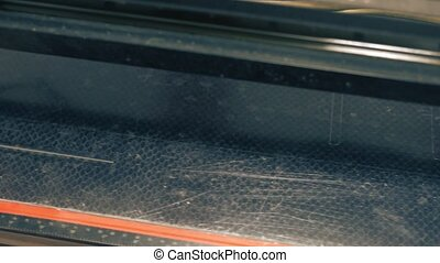 CNC machine cutting parts with laser in workshop - From...