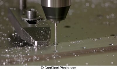 Cnc machine working. Drill in action close up.